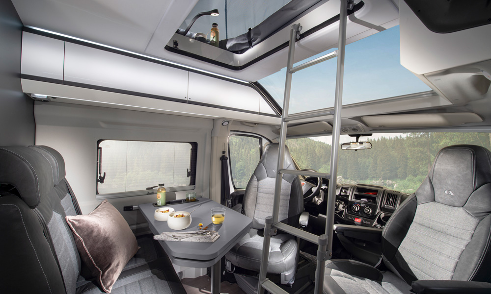 Seating area in the city caravan Twin Sports Edition with access to the bedroom on the roof.
