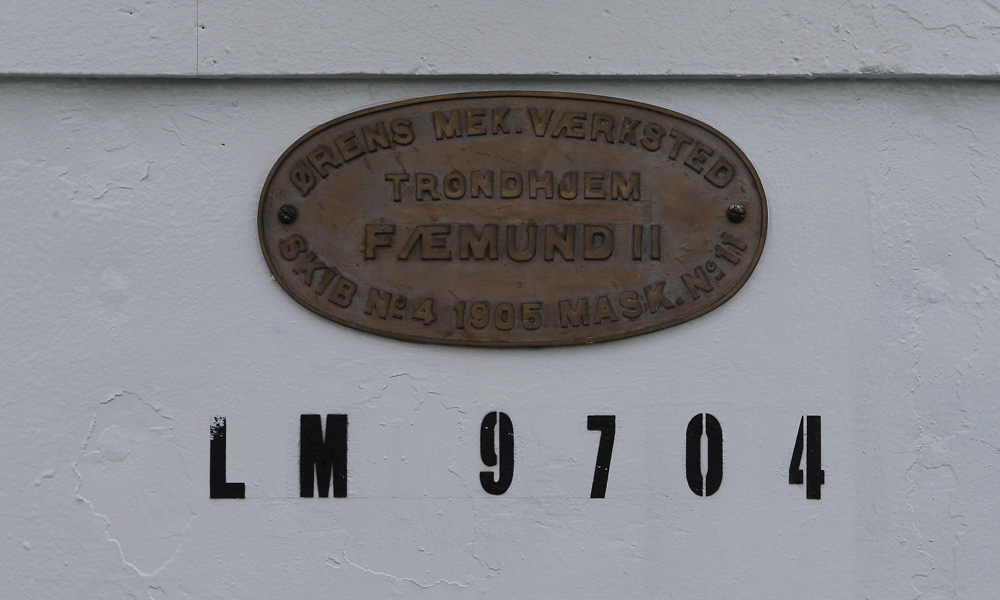 This historic sign is attached to the wall of the ship Fæmund II.