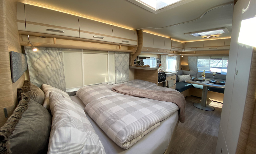 Large double bed located in the middle of the carriage